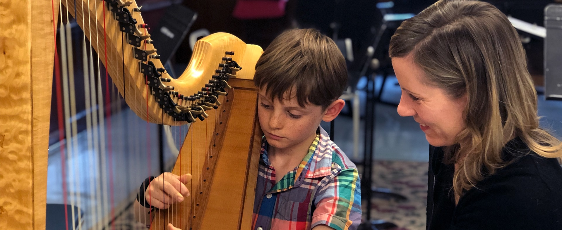 Young student learning harp